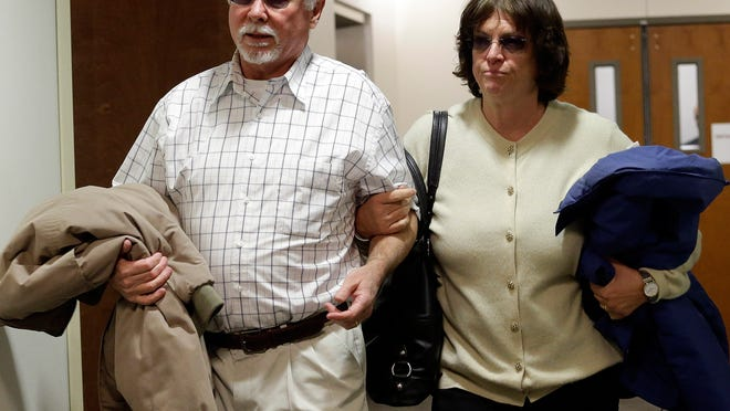 Robert and Arlene Holmes, the parents of Aurora theater shooting suspect James Holmes, arrive at district court for the arraignment of their son on March 12, 2013.