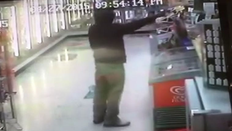 The robber pointing a gun inside Mary's Store in Newport