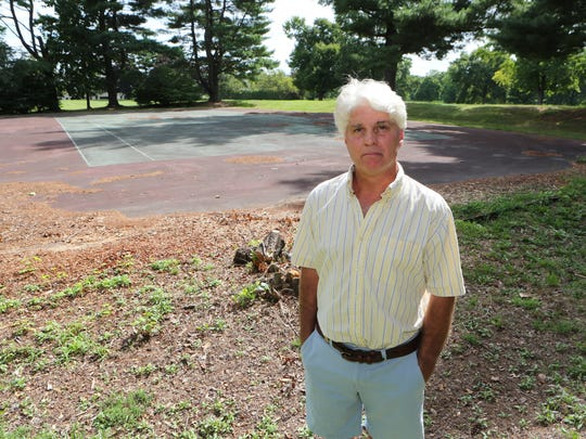 Padraic Lee, a White Plains resident in the  Gedney Farms neighborhood, opposes the tentative deal between the French-American School of New York (FASNY) and the city of White Plains, Sept. 2, 2016. Here he is pictured at the site of the property, with the abandoned tennis courts, at the old Ridgeway Country Club.