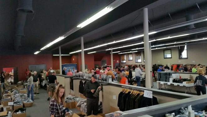 Shoppers look through Baretta clothing and accessories at the 2016 pop-up sale in Gallatin.