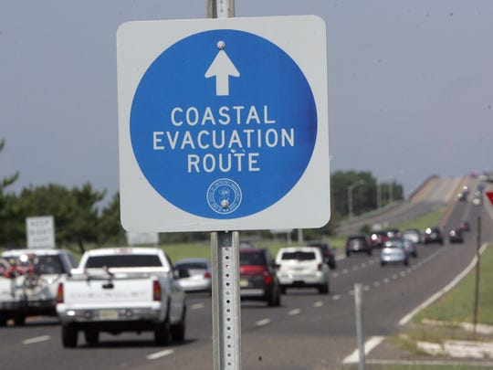 Cars head west on Route 72 in Stafford Friday. Heeding the advice of state and local officials, visitors to Long Beach Island took the evacuation route away from the island. Tim McCarthy/Staff Photographer Stafford Twp. 08/26/11 Heeding the advice of state and local officials, many visitors to Long Beach Island took the evacuation route away from the island. Cars head west on Rt. 72 .__Tim McCarthy/Staff Photographer