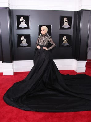 Lady Gaga strikes a red carpet pose.
