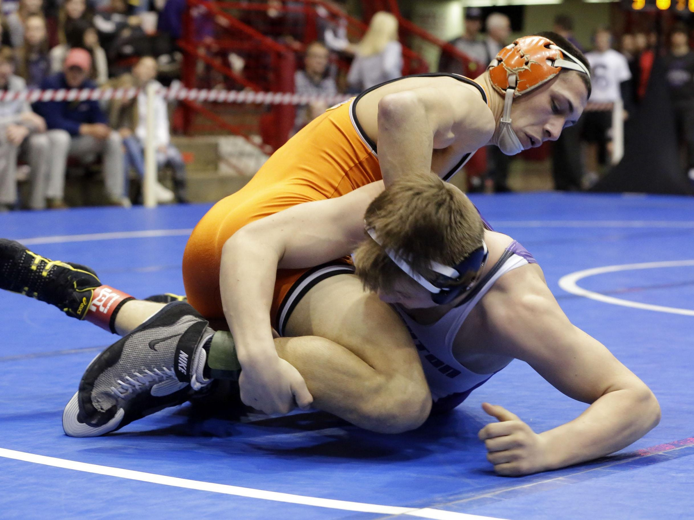 Kaukauna's Trent Leon, top, wrestles Stoughton's Luke Spilde at 138 pounds on Saturday in Madison.