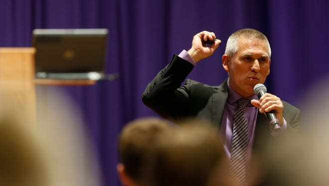 University of Northern Iowa presidential candidate and interim president Jim Wohlpart walks into the crowd as he speaks at the Presentation and Open Forum in Maucker Union Wednesday, Nov. 30, 2016, in Cedar Falls, Iowa. (Matthew Putney/The Courier via AP)