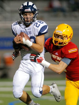 Palma's Tristan Wahl prepares to tackle Aptos' Danner Pardue during their football game Friday at Rabobank Stadium in Salinas,