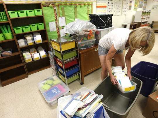 First grade teacher, Debbie Vandivert at Truman Elementary School, sets up her classroom last week. Nearly 25,000 students are expected to show up when classes start on Thursday.
