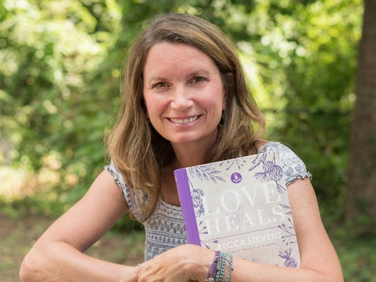 Rev. Becca Stevens, founder of Nashville women's healing center Thistle Farms, with her 2017 book Love Heals
