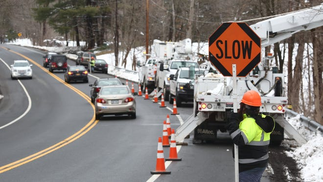 A Texas based Central Hudson subcontractor works on utility lines along Route 9 in Hyde Park on March 8, 2018.