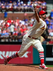 St. Louis Cardinals starting pitcher Adam Wainwright (50) pitches during the fourth inning against the New York Mets at Busch Stadium on July 8, 2017.