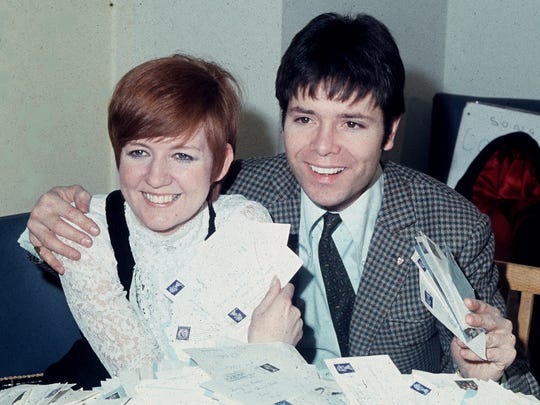 """In this March 8, 1968, photo, singer Cilla Black counts votes with singer Cliff Richard for Britain's """"Song For Europe,"""" in Shepherd's Bush, London."""