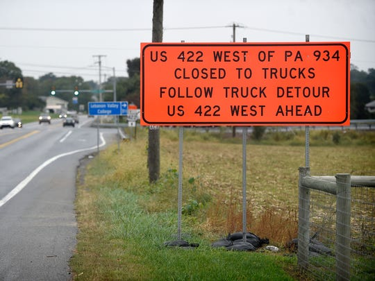 Signs on 322 just East of 934 warn motorists of delays caused as construction vehicles come and go from pipeline construction areas.