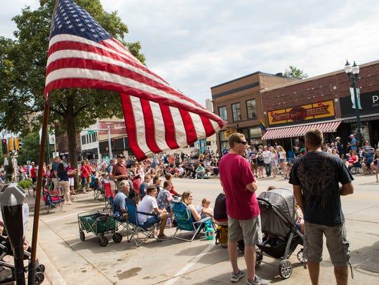 Parade goers enjoy the Independence Day celebration