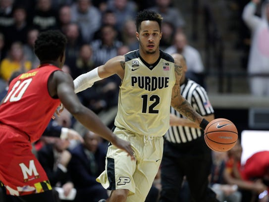 Purdue forward Vincent Edwards (12) brings the ball