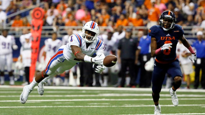 Louisiana Tech wide receiver Carlos Henderson (1) dives for a catch against UTSA Roadrunners corner back Aneas Henricks (6) during the first half at Alamodome in October.