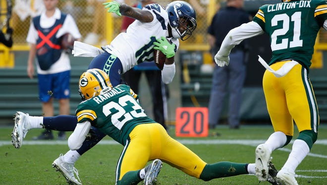 Green Bay Packers defensive back Damarious Randall  tackles Seattle Seahawks wide receiver Paul Richardson during the fourth quarter of Sunday's game at Lambeau Field in Green Bay, Wisconsin.
