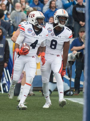 Auburn wide receiver Jason Smith (4) celebrates with Auburn wide receiver Tony Stevens (8) after scoring a touchdown during the NCAA football game in the Birmingham Bowl on Wednesday, Dec. 30, 2015, at Legion Field in Birmingham, Ala.