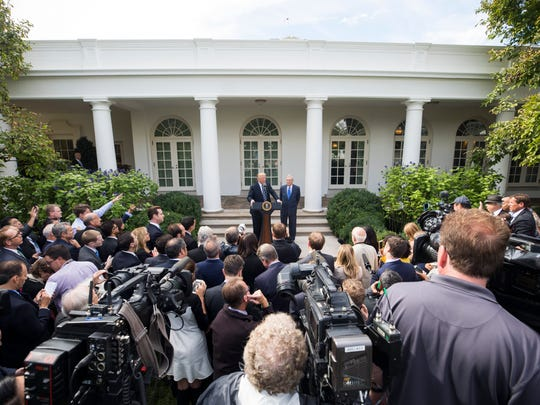 President Trump and Sen. Mitch McConnell, R-Ky., talk to reporters at the White House on Oct. 16, 2017.
