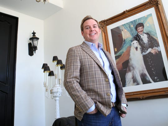 """Christopher Kennedy poses inside a home he designed and used to belong to Liberace. His work will again be featured on HGTV's """"House Hunters Renovation"""" on Aug. 19, 2017."""