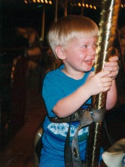 Rob Moss as a child is pictured in an undated photograph.
