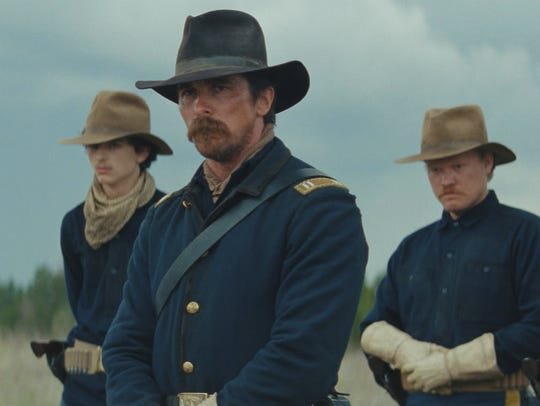 "Christian Bale, center, in a scene from ""Hostiles."""