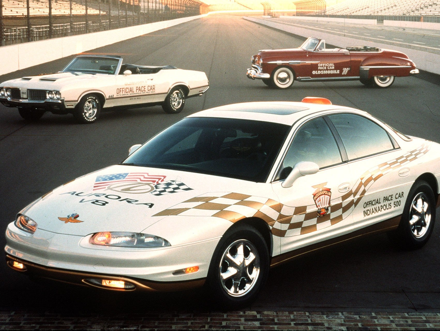 Oldsmobile Pace Cars past and present. The Aurora V8, front, is the latest Official Pace Car for the Indianapolis 500.