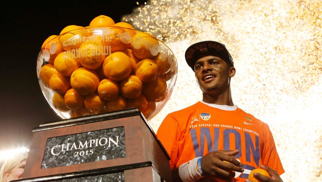 Clemson quarterback Deshaun Watson (4) poses with the Orange Bowl trophy following an NCAA college football semifinal playoff game against Oklahoma, Thursday, Dec. 31, 2015, in Miami Gardens, Fla. Clemson defeated Oklahoma 37-17. (AP Photo/Joe Skipper)