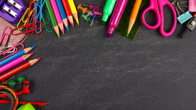Chalkboard with school supplies corner border
