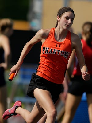 West De Pere's Brehna Evans stays in stride as she competes in the 3,200-meter relay during last year's WIAA Division 1 sectional at Bay Port High School in Suamico. Evans placed fifth in the 800 and helped the 3,200 relay place sixth at state last year.