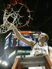 Nevada's Nick Fazekas cuts down the net after the Wolf