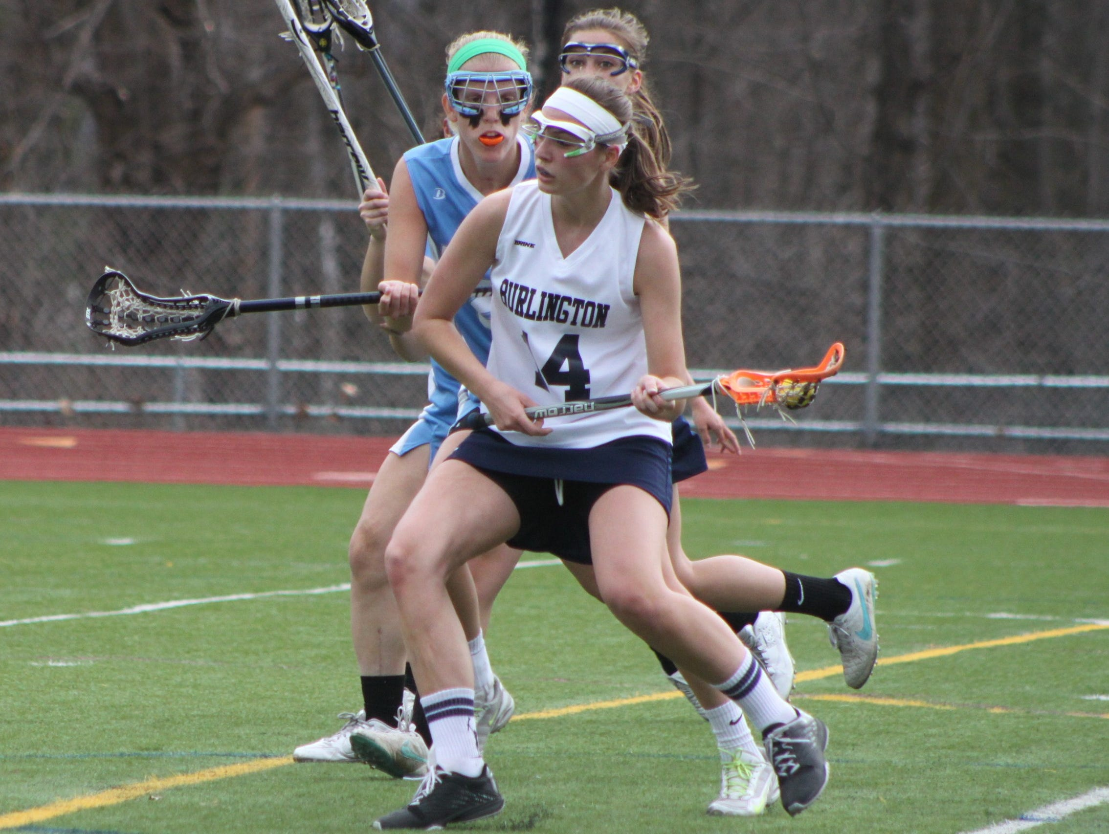 Burlington's Casey O'Neill protects the ball against South Burlington's Sarah Fisher during a girls lacrosse game on Thursday.