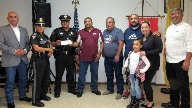"The Loyal Order of Moose is once again donating dollars from its video gaming revenues. ""Rocking the Streets,"" motorcycle run in memory of Ramon ""Momo"" Pena III, has received  a $500 donation from Lodge 2088.. The annual bike run, now in its sixth year, has generated scholarship money for graduating Deming High School seniors each year and also makes charitable contributions to six children and families to help pay for medical expenses. Moose Lodge Governor and Administrator Jerry Rivera is proud of the members for helping with this effort. Pictured, from left, are: City of Deming Mayor Benny Jasso, New Mexico State Police Officer Bobbie Terrazas, New Mexico Transportation Police Officer Allan Ballinas, Moose Junior Governor George Cobos, Moose Lodge Governor Manny Garcia, Manny, Vanessa and Emily Armendariz and David Baeza."