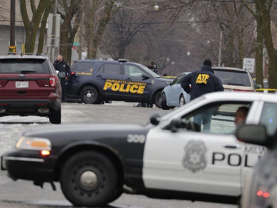 Milwaukee police block the intersection of 12th and Dakota after a Milwaukee Police officer was shot Wednesday, Feb. 6, 2019, on the city's south side.