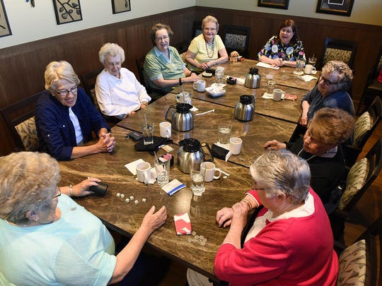 A group of friends gather for their weekly game of Farkle at Country Manor Campus in Sartell.