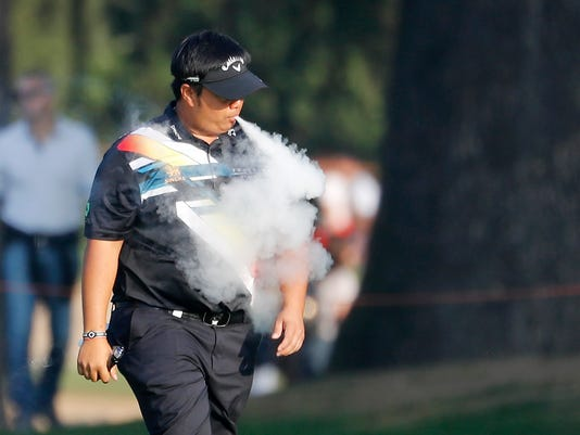 Kiradech Aphibarnrat, of Thailand, puffs a electronic cigarette during the 74th Italy Open Golf tournament in Monza, Italy, Saturday, Oct. 14, 2017. (AP Photo/Antonio Calanni)