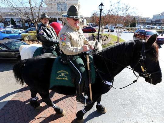 """Sgt. Jon Levi, foreground, riding Lushy, and Deputy Kerry Nelson on Lenny are deputies with the Rutherford County Sheriff's mounted patrol. Levi has """"resigned in lieu oftermination,"""" the sheriff's office said."""