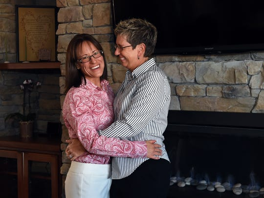Photo from 2014: Karen Vibe, left, and Karen Goody pose for a photograph in their Reno home. The couple was the first same-sex couple to obtain a marriage license in Washoe County.