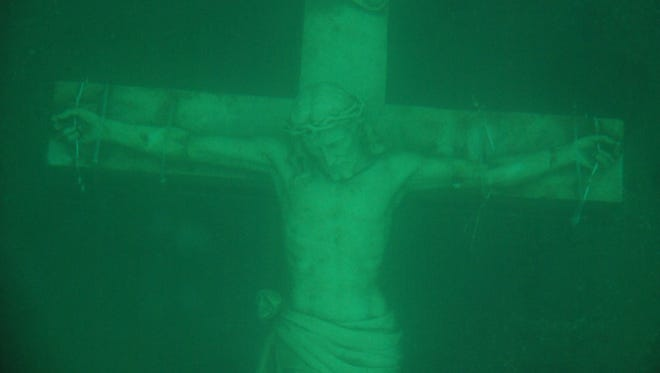 Crucifix under water in Little Traverse Bay.