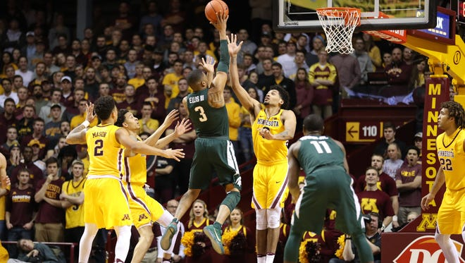 Michigan State Spartans guard Alvin Ellis shoots for two of his career-high 20 points during the Spartans' 75-74 overtime win at Minnesota Tuesday night.
