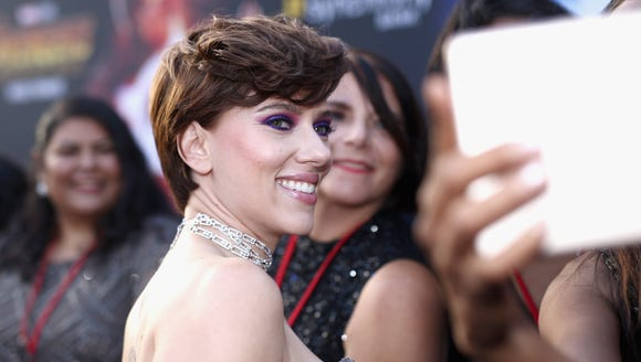 Scarlett Johansson smiles for photos at the 'Avengers: