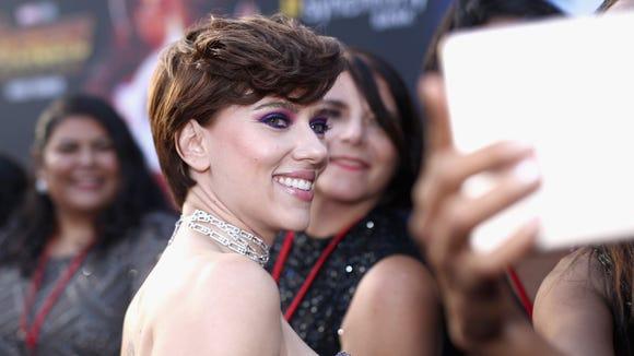 Scarlett Johansson smiles for photos at the 'Avengers: