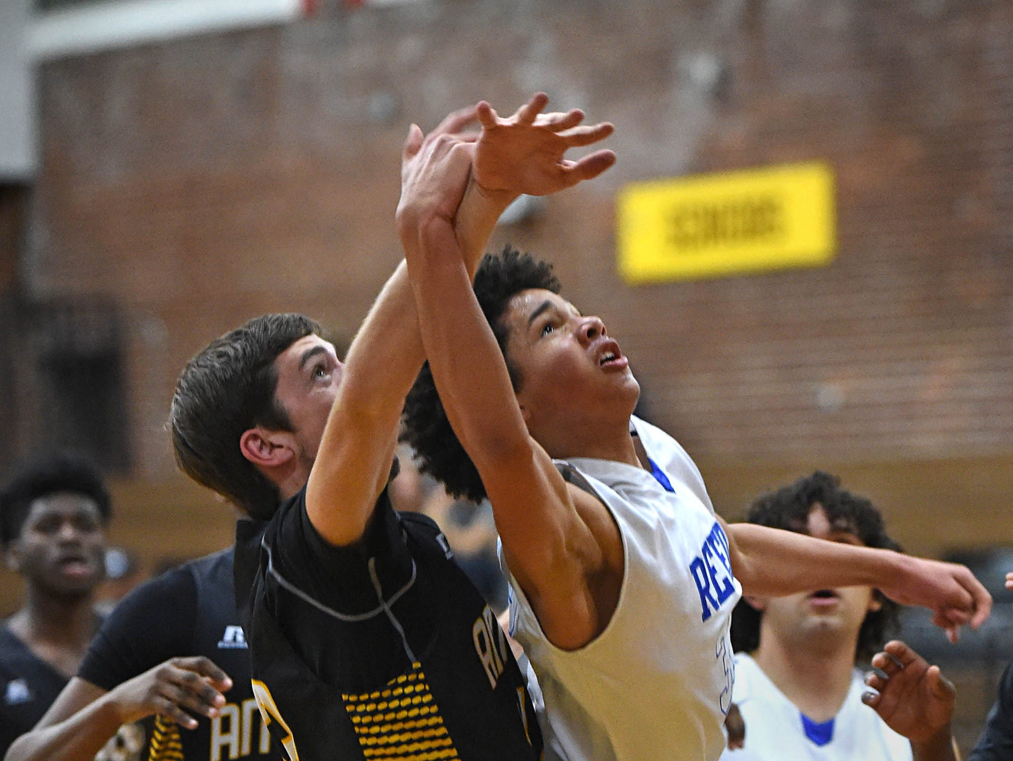 Antioch's Tyler Krieg attempts to block a shot by Reed's Matthew Williams during the Rail City Classic Basketball Tournament at Sparks High School on Tuesday.