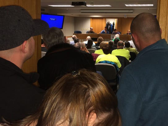 More than 60 people jammed a meeting room in Green