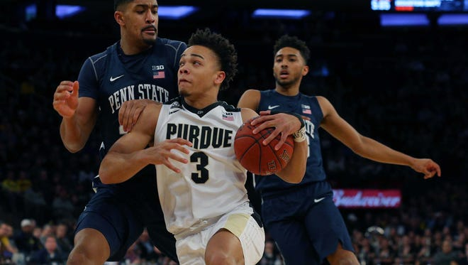 Mar 3, 2018; New York, NY, USA; Purdue Boilermakers guard Carsen Edwards (3) drives past Penn State Nittany Lions forward Julian Moore (44) and Penn State Nittany Lions guard Josh Reaves (23) during the first half of a semifinal game of the 2018 Big Ten Tournament at Madison Square Garden. Mandatory Credit: Brad Penner-USA TODAY Sports