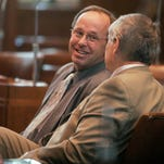 """Senators Jeff Kruse, R-Roseburg, left, and Doug Whitsett, R-Klamath Falls converse on the Senate floor in June 2011. The two have """"suspended"""" their participation in creating a transportation package in protest of another bill."""