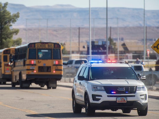 First responders secure a perimeter outside Pine View High School in St. George on Monday, March 5, 2018. The school was evacuated after a school resource officer was notified of a suspicious incident.
