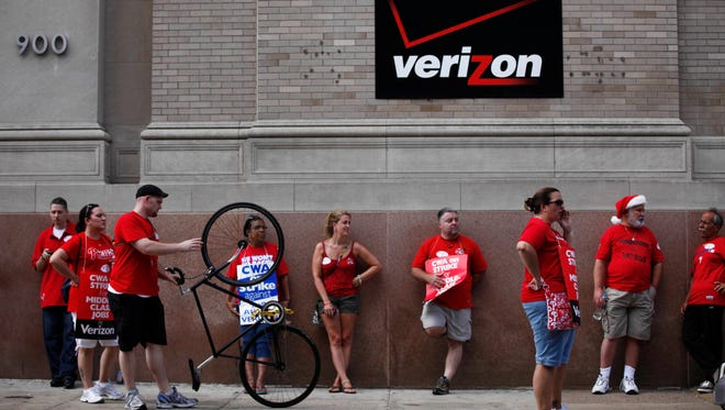 In this Aug. 8, 2011 file photo, Verizon workers picket outside one of the company's central offices in Philadelphia. Verizon landline and cable workers in nine eastern states and Washington, D.C., are expected to walk off the job Wednesday, April 13, 2016, after working without a contract since August. (AP Photo/Matt Rourke, File)