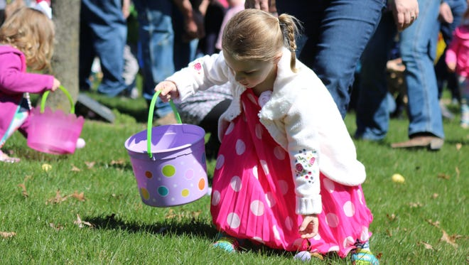 Cora Kapp, 3, finds an egg during the annual East Egg Hunt in Oak Harbor on Saturday.