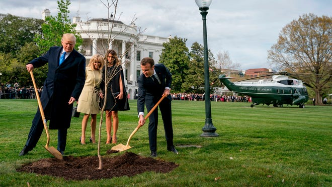 First lady Melania Trump and Brigitte Macron watch April 23 as President Trump and French President Emmanuel Macron participate in a tree planting ceremony on the South Lawn of the White House.