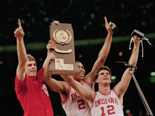 Indiana players Todd Meier (from left), Daryl Thomas