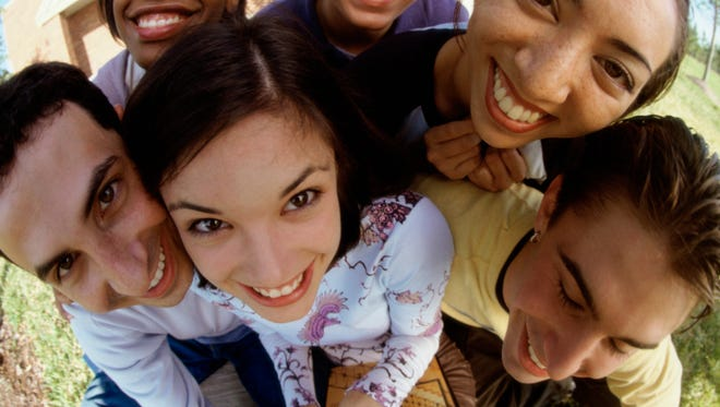 Portrait of a group of teenagers smiling